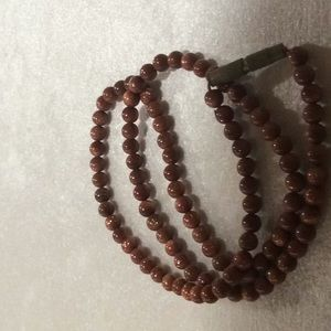 Shimmery golden brown bead necklace.($5x3)